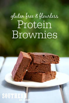 This Healthy Protein Brownie Recipe is made with just seven ingredients but each brownie contains over 11 grams of protein! Gluten free, low fat, low carb, low calorie, clean eating friendly and flourless with grain free/paleo options.