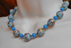 Hey, I found this really awesome Etsy listing at https://www.etsy.com/listing/505507828/wedding-cake-necklace-venetian-glass