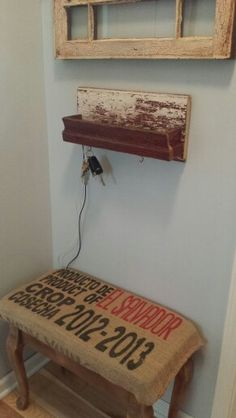 Bench with coffee bag cushion. Wallet keys and phone charging shelf under a crackled window we found.