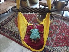 Baby sleeping in the cloth hanging cradle Hanging Cradle, Hanging Fabric, Baby Sleep, Baby Love, Making Out, Toddler Bed, Google Search, Antiques, Modern
