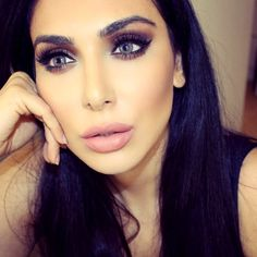 Huda Beauty wearing Solotica Hidrocharme Ice lenses available at luxelenses.com