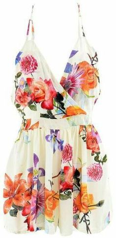 DETAILS: Beautiful floral playsuit Floral printV surplice…
