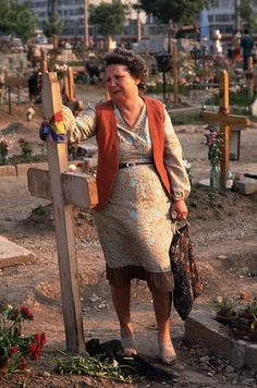 A woman mourns at the grave of a loved one who died fighting in the Romanian Revolution of 1989. (May 18 1990)