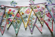 Such pretty bunting made out of old embroidered handkerchiefs.