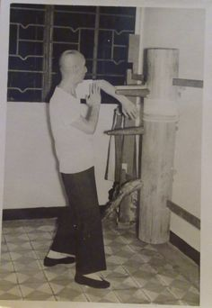 Wing Chun Grandmaster Ip Man practicing on a wooden dummy in 1967.9