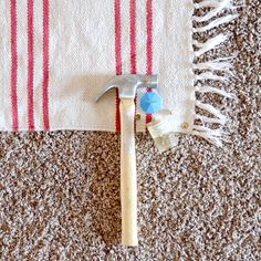 Use upholstery tacks to keep rugs on carpet in place (I Still Love You)