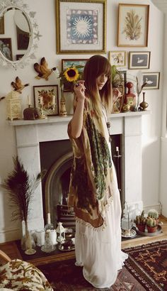 Bohemian, long white dress, kimono, photo gallery above the fireplace