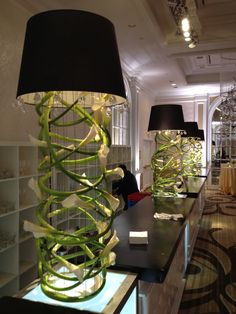 @capitaldecorandevents, fresh flowers spun into a lamp for an organic, architectural element.