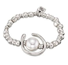 Unique elastic bracelet made with rounded beads, a silver-plated hoop and a white pearl. Hand-crafted in Spain.