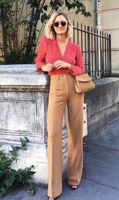 Make classic trousers softer with a feminine blouse.
