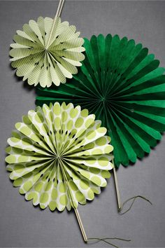 Folding Paper Fans, could be made easily with popsicle sticks or chopsticks for the handles.