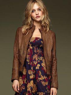 leather bomber-like jacket. cute dress.