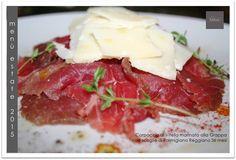 Carpaccio di Vitella marinato alla Grappa con scaglie di Parmigiano Reggiano 36 mesi