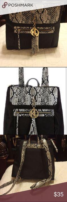 Kate Landry Black Black and Gray Bookbag Kate Landry Black Bookbag with animal print straps and gold metal accents. Kate Landry Bags Backpacks