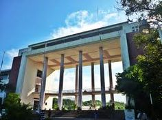 An art site. The Quezon Hall, where the famous oblation statue can be found. Located at the western end of the symmetrically paid-out central core of the campus. The hall was designed by a National Artist for architecture who is also recognized as the pioneer of modern Philippine architecture, JUAN NAKPIL.  The hall is buttressed by huge pillars which reminiscent of neoclassical architecture.