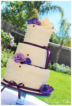Ivory and Purple Wedding Cake... But peacock blue instead of purple.