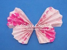 Folded Butterfly Crafts! I saw these at my friends wedding, you can make them out of any type of paper!