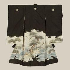A fine plain silk miyamairi kimono worn during ceremonial anointment at a Shinto shrine. The kimono features the classic auspicious motifs of cranes and pine trees, yuzen-dyed.  Meiji period (1868-1911), Japan.  The Kimono Gallery