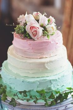 Pastel three-tiered wedding cake in rainbow colours. Via Stay at Home Mum.com