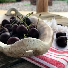 Food styling photo with cherries. Wood fired pottery by Cynthia McDowell.