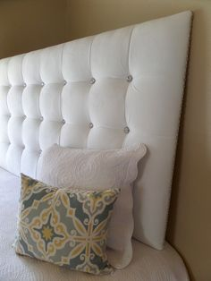 King sized extra tall white velvet tufted upholstered headboard with crystal buttons and crystal nail trim custom wall mounted