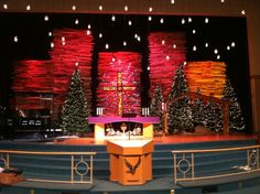 Pallet Skyscrapers - Church Stage Design Ideas - Scenic sets and stage design ideas from churches around the globe. Christmas Stage Design, Christmas Booth, Church Christmas Decorations, Pallet Christmas Tree, Church Stage Design, Christmas Plays, Blue Christmas, Altar, Christmas Eve Service