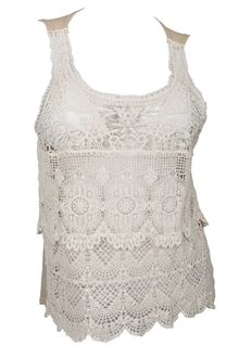 Available in junior plus size 1XL, 2XL, 3XL. Plus size top features sleeveless tank top styling. Beautiful sheer crochet lace fabric. Layer it over your favorite tank or cami top for an instant glam look. Cotton blend.