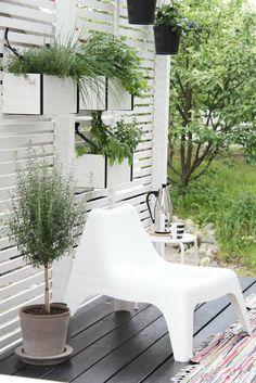 Planters on walls. Pinned to Garden Design - Pots & Planters by Darin Bradbury.