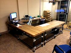 U-Shaped Butcher Block Desk   by Simplified Building Concepts Nice desk here with loads of space, but my inner geek loves the view in the background even more!