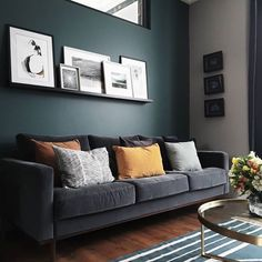 Dark walls, grey velvet sofa, prints on a shelf and mustard cushions in this living room – grey Dark Green Living Room, Dark Walls Living Room, Living Room Color Schemes, Living Room Carpet, Living Room Sofa, Home Living Room, Living Room With Grey Sofa, Living Room Color Combination, Teal Living Rooms