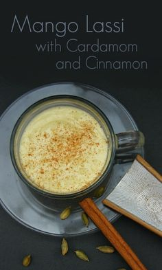 Mango Lassi with Cardamom and Cinnamon. This is mango heaven. Creamy, sweet and a warmth from the spices. I love it!   #easyrecipes #mangoes #smoothies