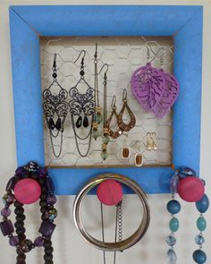 I have one of these in my room! It's really handy for all my jewelry that needs to be hung up:)
