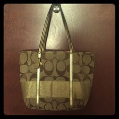 Authentic Coach handbag Gold coach handbag with shoulder straps. Slight staining on inside of the bag, reflected in price. Coach Bags Totes