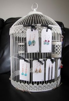 http://www.etsy.com/shop/bailybelle  Birdcage used as earring display by Baily Belle.