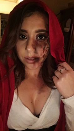 Little red riding hood mangled by the wolf! A darker take for a cool Halloween costume that you don't need to buy anything for!! Normal makeup products were used and tissue paper was used for the scratches