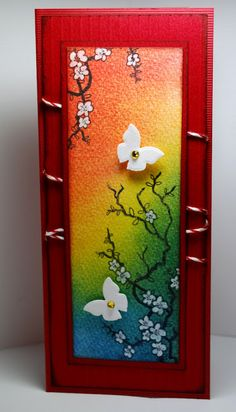 card with Asian cherry blossom design...bright red card base...pan pastels colored the image panel...