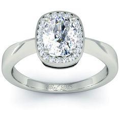 Cushion cut halo engagement ring with plain band.