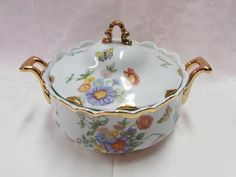 http://www.etagereantiques.com/products/vintage-soup-tureen-flowers-gold This vintage white porcelain soup tureen has a bevy of multi colored wild flowers hand painted on it. ...