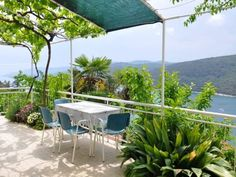 Apartment in Rabac with Two-Bedrooms 4 Rabac Apartment in Rabac with Two-Bedrooms 4 offers accommodation in Rabac, 100 metres from Rabac Ferry Port and 300 metres from Rabac Bus Stop. The apartment is 600 metres from Girandella Beach Rabac. Free WiFi is provided throughout the property.