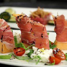 Prosciutto with cantaloupe spears, arugula, tomatoes, & mozzarella. Terrazza Lounge - Santa Monica, California.