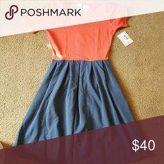 LuLaRoe Amelia dress Size medium, brand new with tags  Coral/blue dress with pockets Retail price is $65, I'm asking $40 LuLaRoe Dresses Midi