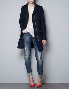 Simple and elegant.  Black coat, detailed embroidered blouse, distressed cuffed jeans, bright pumps