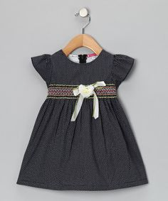 Take a look at this Maggie Peggy Black Smocked Polka Dot Flower Dress by Maggie Peggy on #zulily today!