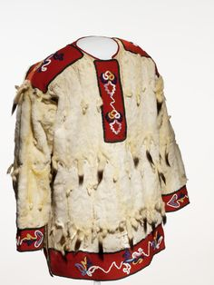 Culture/People:  Tlingit Object name:  Man's tunic Date created:  circa 1890 Place:  Alaska; USA (inferred) Media/Materials:  Ermine skin/fur, glass bead/beads, wool cloth, cotton cloth Techniques:  Sewn, overlay beadwork Collection History/Provenance:  Collected by Lieutenant George T. Emmons (1852-1945, US Navy 1881-1899); purchased by MAI in 1926.