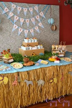 loving the jungle theme baby shower since that is my theme for my baby! this grass skirt idea is cool for a table top.