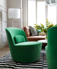Close-up of STOCKHOLM swivel easy chair with a green velvet cover