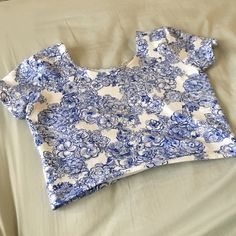 Blue floral AA fitted crop top Style no longer available on American apparel online store ! Worn maybe twice! No wear or stains at all. Colors are as bright as when I bought it. Made of cotton and spandex so it is fitted and stretchy. American Apparel Tops Crop Tops