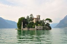 In the middle of the lake is Monte Isola (or Montisola), one the largest islands of any lake in Europe. Lake Iseo or Lago d'Iseo or Sebino is the fourth largest lake in Lombardy, Italy. This is a privately owned island on the lake named Isola di Loreto. Places Around The World, Oh The Places You'll Go, Places To Travel, Places To Visit, Around The Worlds, Beautiful Castles, Beautiful Places, Amazing Places, Amazing Things