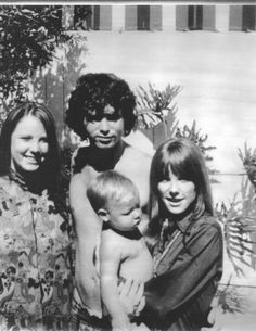 Jim Morrison's sister Anne, Jim, Anne's son and Jim's nephew Dylan in Pamela Courson's arms