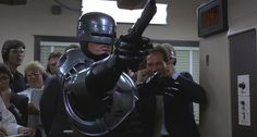 """New RoboCop Movie in Development From Original Writer          Is there anything more frustrating than the RoboCop franchise? The first movie is an undisputed classic, and it would be enough for it to be merely one of the greatest action/sci-fi movies ever made. The fact that it has a thread of sharp (and more and more prescient) satire woven through it only makes it better.    Attention!!! This is Just an Announce to view full post click on the """"Visit"""" Button Above"""